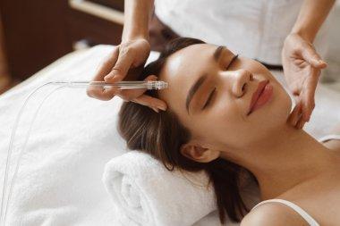 Facial Beauty Treatment. Woman Getting Oxygen Water Skin Peeling