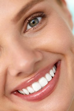 Beautiful Smile. Smiling Woman Face With White Teeth, Full Lips