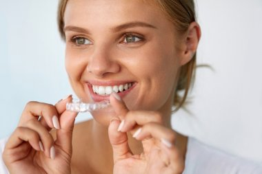 Smiling Woman With Beautiful Smile Using Teeth Whitening Tray