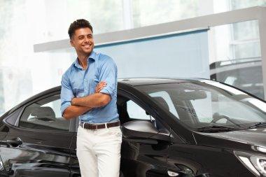 Happy Man near Car of His Dream.