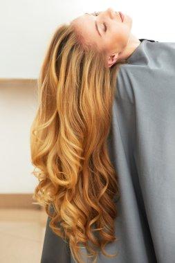Blonde woman in hair salon