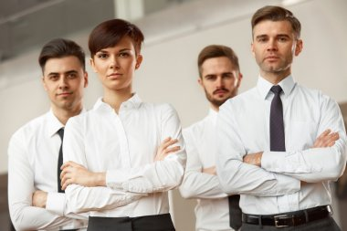 Business people standing with folded hands