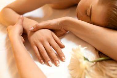 Hand Massage. Beautiful Blonde Gets Spa Treatment in Salon.