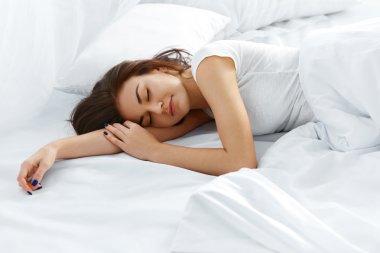 Attractive woman sleeping in bedroom
