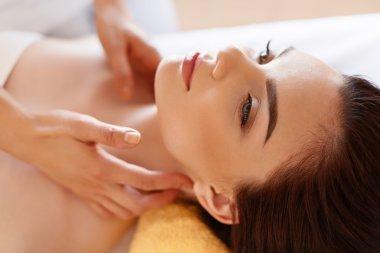 Spa Massage. Beautiful Woman Gets Spa Treatment in Salon.