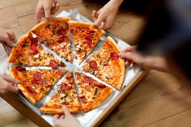 Eating Pizza. Group Of Friends Sharing Pizza. Fast Food, Leisure