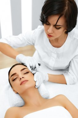 Plastic Surgery. Woman Gets Cosmetic Injection. Cosmetology. Bea