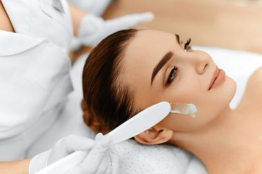 Skin Care. Cosmetic Cream On Woman's Face. Beauty Spa Treatment