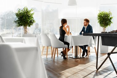 Couple In Love Celebrating. Romantic Dinner In Restaurant. Roman