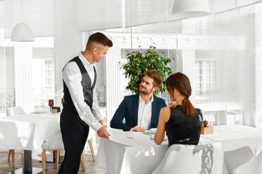 Dinner In Restaurant. Waiter Serving Romantic Love Couple. Valen