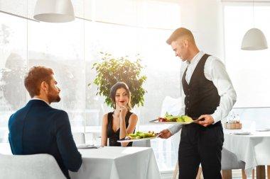 Love Couple Having Romantic Dinner In Restaurant. Healthy Food E