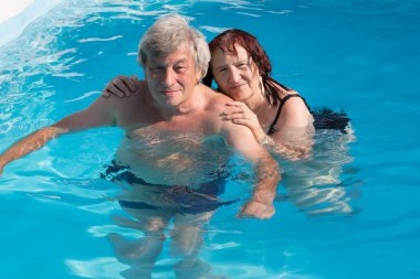 Senior couple in a swimming pool