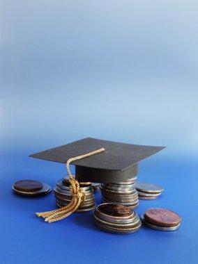 grad cap and coins