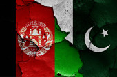 flags of Afghanistan and Pakistan painted on cracked wall