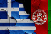 flags of Greece and Afghanistan painted on cracked wall
