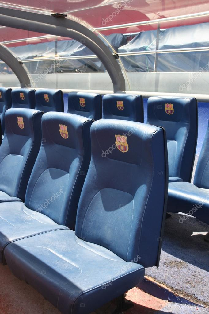 BARCELONA, SPAIN - JUNE 12, 2011: Blue reserve players seats with symbols on Camp Nou Stadium in Barcelona. Camp Nou is the home arena for FC Barcelona and seats 99786 people