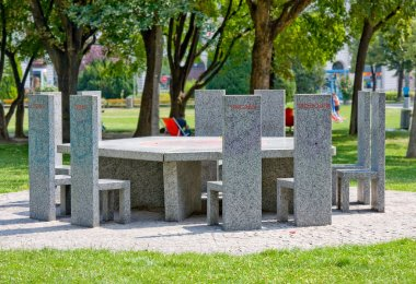 VIENNA, AUSTRIA - JULY 27, 2014:Marble table called Partner of all nations, memorial with ten marble chairs in Sigmund-Freud-Park. On chairs names of the countries that joined the EU in 2004