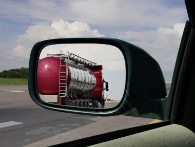 Truck in the rearview mirror.