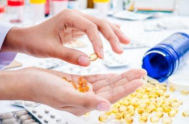 handling fish oil pill