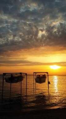 sunset over the sea and boats