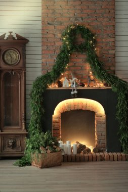 fireplace with candles and pine needles