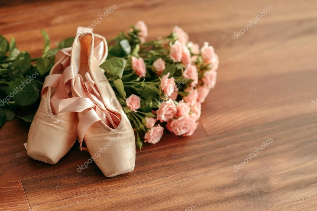 bouquet of pink roses and pointe shoes