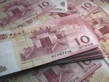 Money of Macao. Macanese pataca bills. MOP banknotes. 10 patacas. Business, finance, news background.