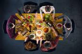 Top view of friends at table with food