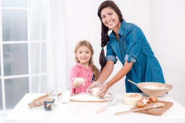 Happy mother and daughter baking