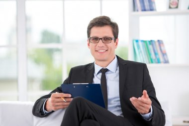 Portrait of smiling psychologist in office