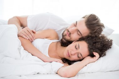 Sleeping couple in the bed