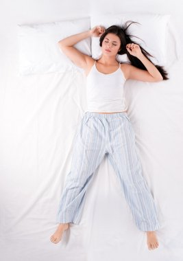 Woman sleeping in free fall position