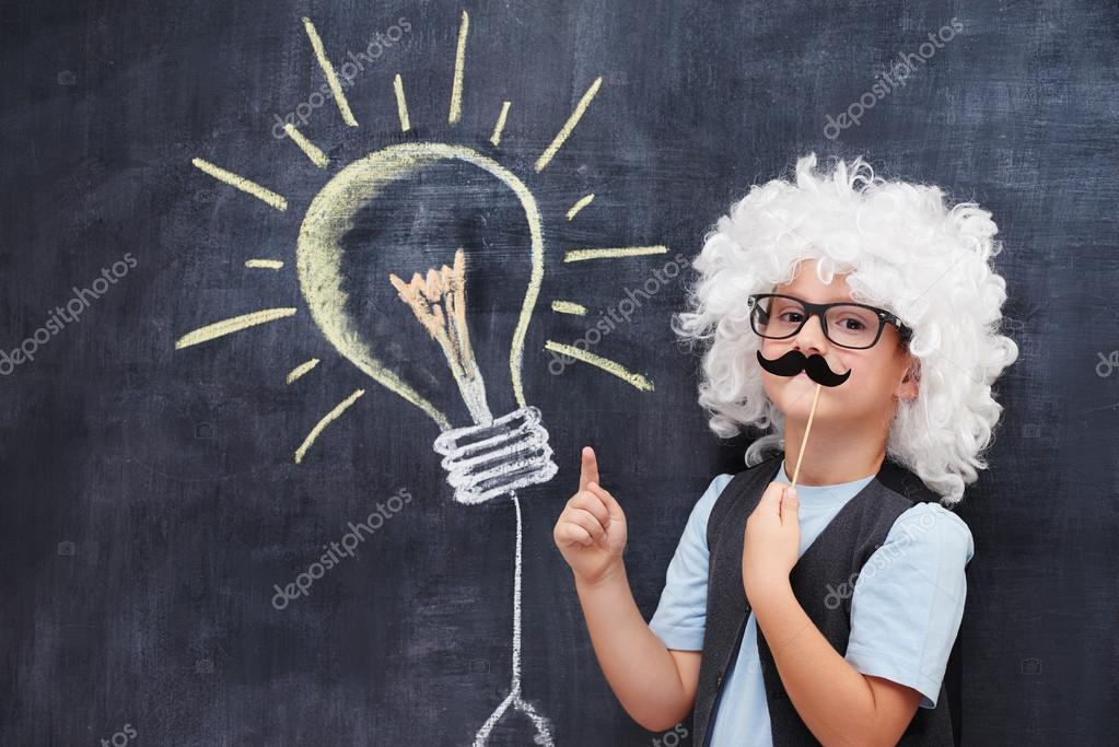 Portrait of male elementary school student in Einstein costume