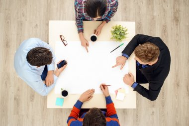Top view table with group of working people