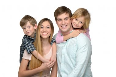 Cheerful young family of four enjoying time together