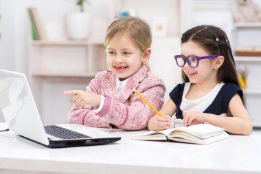 Little girls playing role of businesswomen