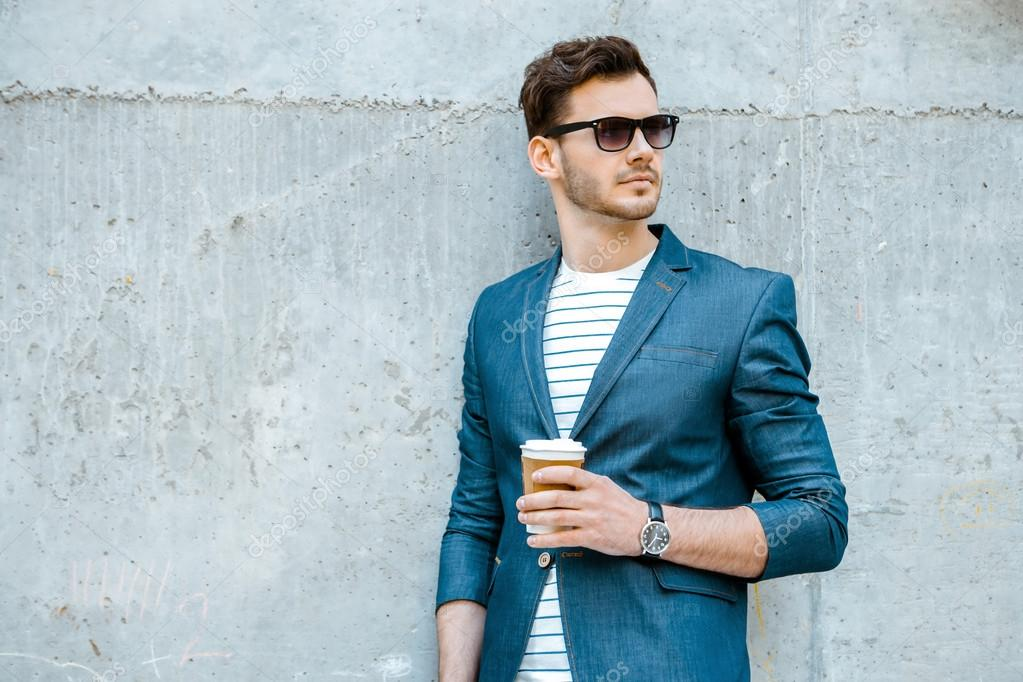 concept for stylish young man outdoors stock photo