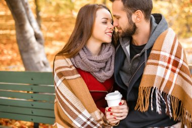 Nice concept for young couple in autumn park
