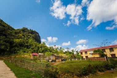 """Картина, постер, плакат, фотообои """"солнечный пейзаж в деревне племени ар-плебе, национальный парк фонг някэ банг, вьетнам. сельские пейзажи, сделанные в юго-восточной азии."""", артикул 464249554"""