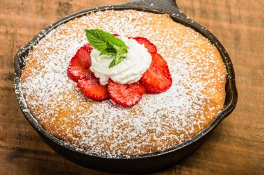 Skillet baked yellow cake with berries