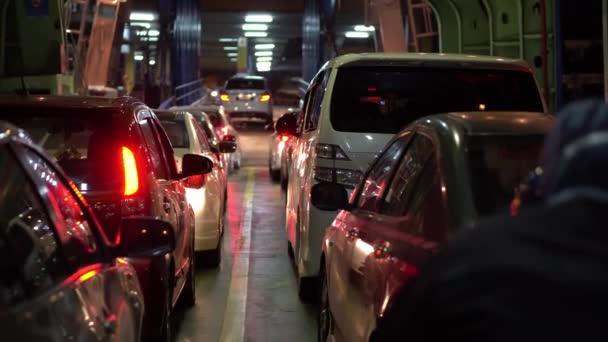 Car in the ferry arrive terminal prepare to disembark