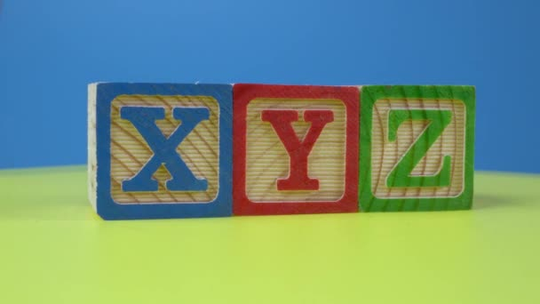 Wooden block in alphabet XYZ rotate. Child education learn concept