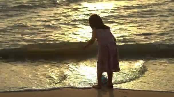Little kid girl wear face mask get sea water at seashore