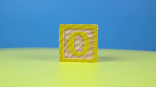 Close up shot letter O alphabet wooden block on surface