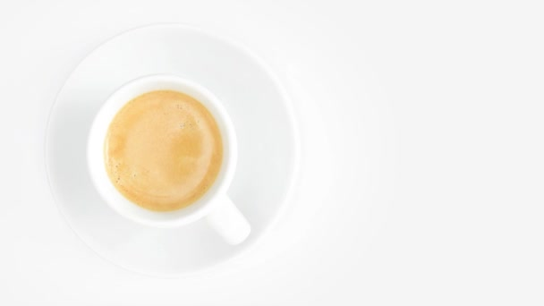 Cup of coffee rotating on white background