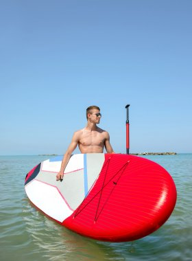 Boy on stand up paddle