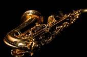 Photo Lying saxophone on black background