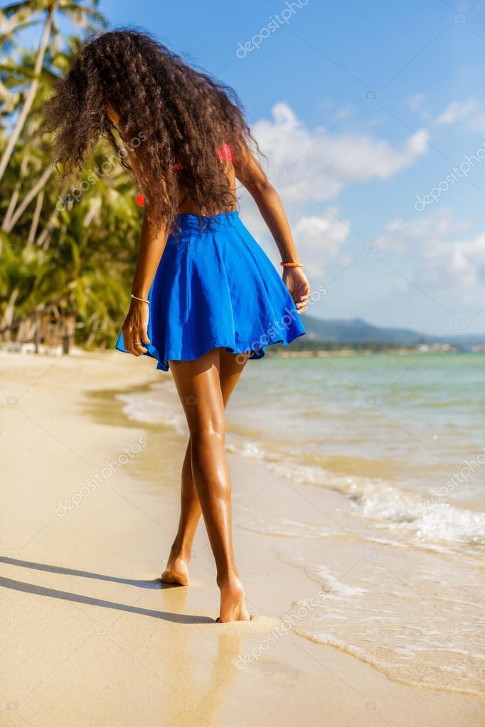 Beach nude with legs apart