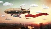 Luftschiff mit einem Banner über einer Stadt