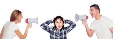 Scared boy between his parents